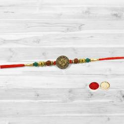 Dazzling Designer Swastik Rakhi with free Roli Tilak and Chawal for your Brother