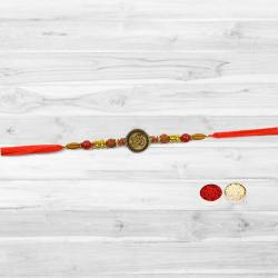 Remarkable Rakhi Gift of Om Design Rakhi with free Roli Tilak and Chawal