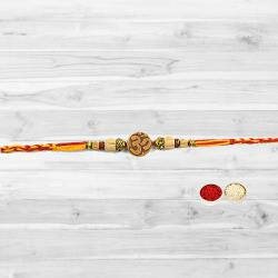 Auspicious Gift of Pious Om Designer Rakhi with free Roli Tilak and Chawal