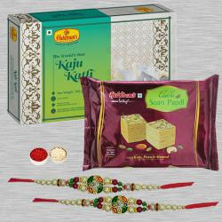 Soothing Set of 2 Ethnic Rakhi with Assorted Sweets, Card N Roli Chawal
