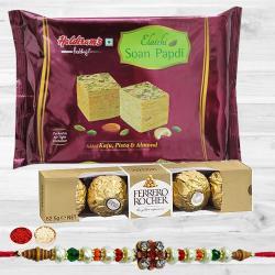Dazzling Stone Rakhi with Tasty Soan Papdi N Ferrero Rocher