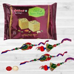 Delightful Set of 2 Lumba Rakhi N Tasty Soan Papdi with Free Roli Tika N Card