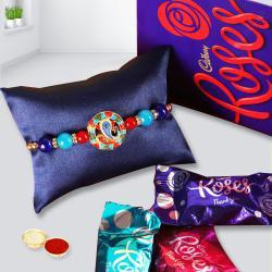 Classy Gift of Rakhi, Cadbury Roses with Free Roli Chawal N  Card