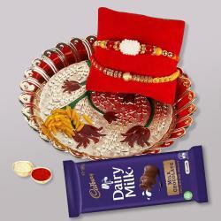 2 Fancy Rakhis, Puja Thali N Cadbury Dairy Milk with Free Card