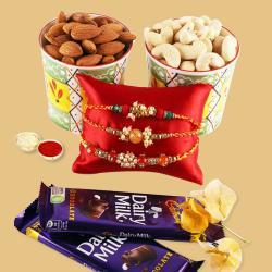Attractive Set of 3 Rakhis, Mixed Nuts N Cadbury Dairy Milk