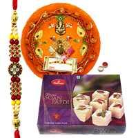 Delicate Combo of Charming Rakhi, Pooja Thali And Haldiram Soan Papdi