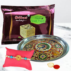 Admirable Peacock Rakhi with Thali n Soan Papdi