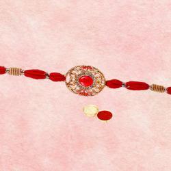 Glamorous Red N Golden Rakhi with Roli Tika N Greeting Card