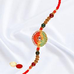 Magnificent Dual Color Rakhi with Free Roli Chawal Tika N Card