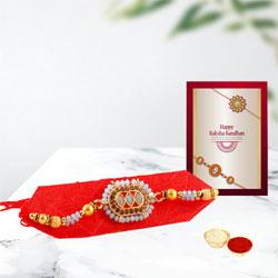 Suave Golden Rakhi with Roli Chawal Teeka n Message Card