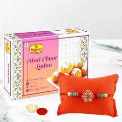 Soothing Dual Color Rakhi with Laddoo, Card N Roli Chawal Tika