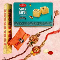 Auspicious Rakhi Set of 3 with Soan Papdi N Toblerone Chocolate