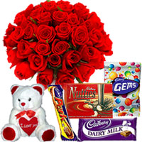 Impressive 12 Red Roses bouquet with attractive Teddy and miscellaneous Cadburys Chocolate