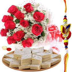 Delectable Kaju Katli and 12 Red Rose Bouquet with Free Rakhi Roli Tilak and Chawal for your Loving Brother