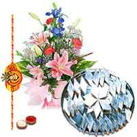 Kaju Katli and Seasonal Flowers Bouquet with Free Rakhi, Roli Tika, Chawal