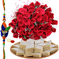 Remarkable Bunch of 50 Red Roses and Sweet Kaju Katli Gift Pack with Free Rakhi, Roli Tika, Chawal for this Special Rakhi Festival