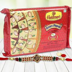 Marvelous Gift Pack of Soan Papri from <font color=#FF0000>Haldiram</font> with Rakhi Roli Tika and Chawal for your Loving Brother