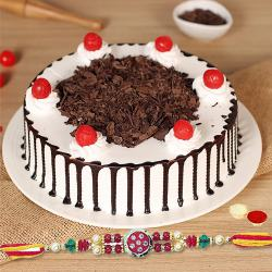 A tempting Black Forest cake along with Rakhi and free Roli Tika and Chawal