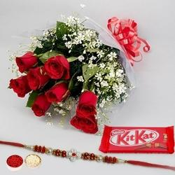 Enticing Gift Pack of Kitkat Chocolate and Bunch of Red Roses with a free Rakhi, Roli Tilak and Chawal for Raksha Bandhan