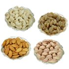 Healthy mixed  Dry Fruits in stylish Silver plated bowls