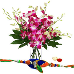 Stylish Gift of Purple Orchids Vase with Free Rakhi Roli Tika and Chawal for the Occasion of Raksha Bandhan (Only for Major Cities / Towns)