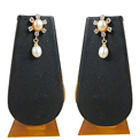 Mesmerizing Star Shaped Pearl Earrings Decorated with AD Stones