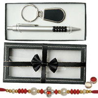 Graceful Key Ring and Pen Gift Set with a Free Pious Rakhi, Roli Tilak and Chawal