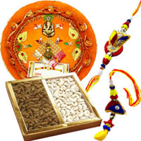 Popular Traditional Rakhi Thali with Bhaiya Bhabhi Special Rakhi and Cashew N Raisins
