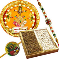 Irresistible Pack of Cashew N Raisin with Bhai Rakhi, Angry Bird Rakhi and Puja Thali