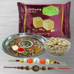 Selective Combo of 2 Rakhi With Meenakari Pooja Thali, Cashews And Soan Papdi