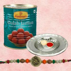 Appealing Ganesh Rakhi With Silver Puja Thali And Gulab Jamun