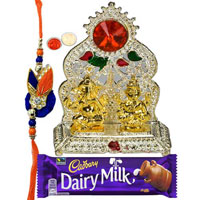 Charismatic Rakhi Celebration Gift of Silver Plated Mandap and Golden Ganesh Laxmi Idol with free Rakhi Roli Tilak and Chawal
