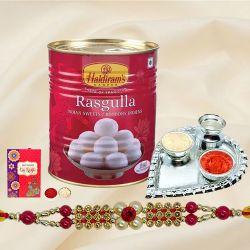 Appealing Thread Rakhi N Haldiram Rosogolla with Silver Plated Thali