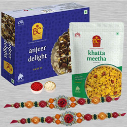 Dazzling Twin Stone Rakhi Set with Sweets N Salty Treats
