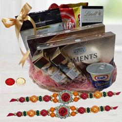 Charming Twin Rakhi Set with Tasty Gourmet Feast Basket