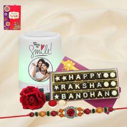 Delightful Stone Rakhi with Personalized Speaker N Handmade Chocolates