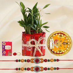 Enticing Stone Rakhi with Bamboo Plant n Kitkat Arrangement n Thali