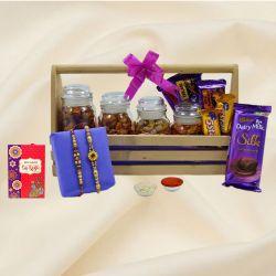 Pretty Stone Rakhi Pair with Cadbury Assortments n Flavor Cashews