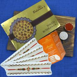 Delicious Balaram Mullicks Rasgulla N Chocolate Imarti with Ganesh Rakhi