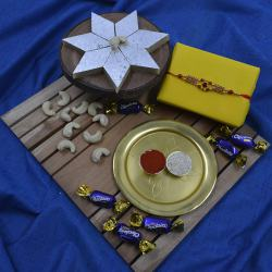 Delightful Gift of Stone Rakhi with Haldiram Kaju Katli, Chocolate N Puja Thali
