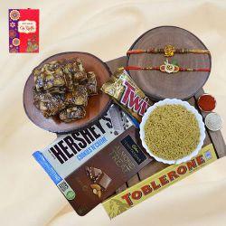Designer Rakhi Set with Haldiram Sweets N Savory  N  Chocolates Hamper