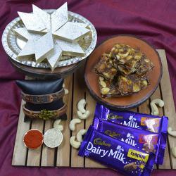 Pious Om Rakhi with Puja Tray, Haldiram Sweets N Cadbury Chocolates
