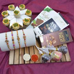 Lovely Rakhi Set of 4 with Haldiram Sweets N Assorted Chocolates