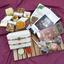 Divine Swastik Rakhi Pair with Haldiram Assorted Sweets N Chocolates