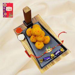 Amazing Om Rakhi with Haldiram Sweets n Cadbury Eclairs