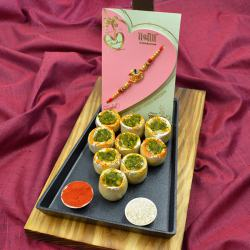 Cool OM-Ganesh Fusion Rakhi with Haldiram Sweet n Cadbury Eclairs