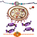 Admirable Selection of Pooja Thali and Cadbury Eclairs Chocolates along with Free Rakhi, Roli Tilak and Chawal