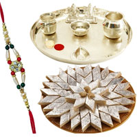 Dazzling Collection of Haldiram Katli and Silver Plated Pooja Thali with Ganesh Lakshmi along with free Rakhi, Roli Tilak N Chawal for your Loving Brother