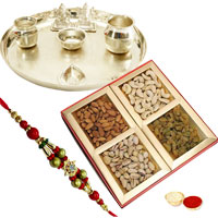 Mesmerizing Gift Set of Assorted Dry Fruits and Decorative Silver Plated Thali with Ganesh Lakshmi with free Rakhi, Roli Tilak and Chawal for the Occasion of Rakhi