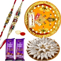 Classy Collection of Kaju Katli, Gift Voucher from Pantaloons N Pooja Thali with 2 Free Rakhi, Roli Tilak and Chawal on Raksha Bandhan